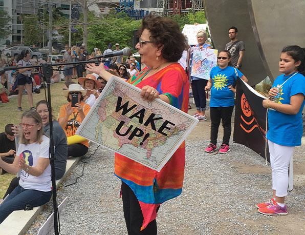 Founder Carol Lewis speaks to crowd